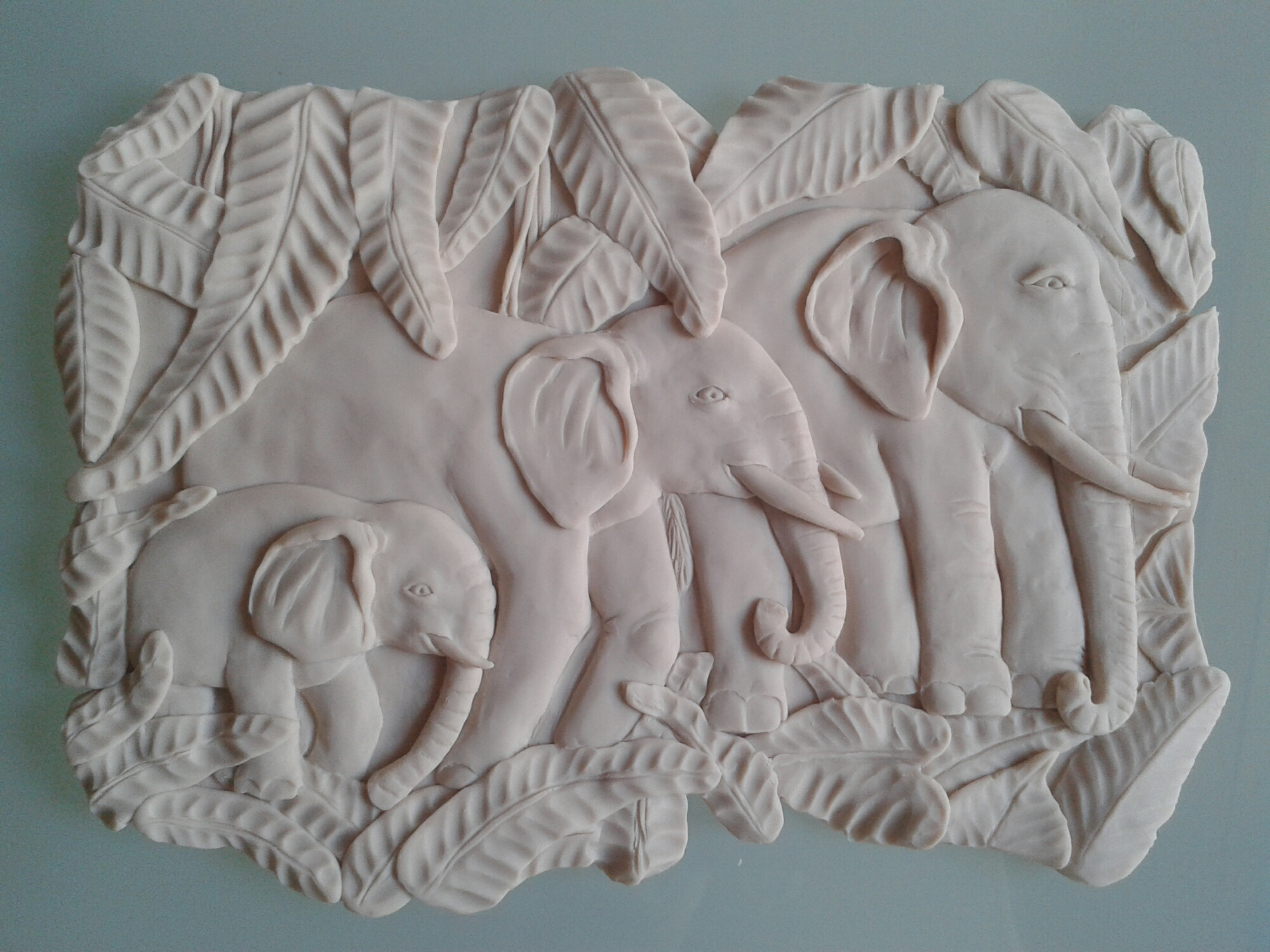Bas relief elephants orange cat sculpting